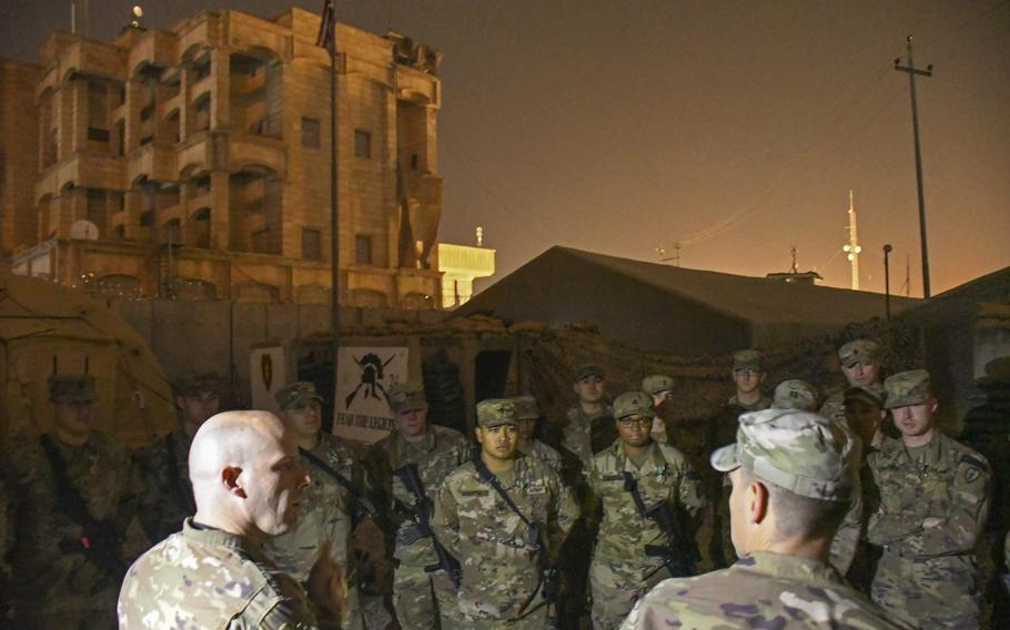 Col. Matthew W. Brown, commander of the 1st Stryker Brigade Combat Team, 25th Infantry Division, speaks to troops of the 1st Battalion, 24th Infantry, following an awards ceremony at a camp in Mosul, Iraq, on Thursday, Dec. 26, 2019.