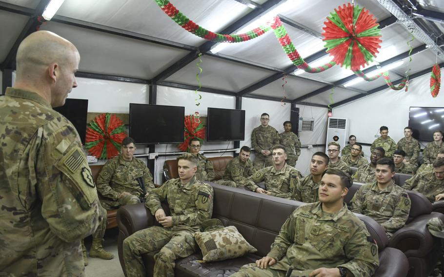 Troops from the 1st Battalion, 24th Infantry gather for a discussion with their brigade commander, Col. Matthew W. Brown, head of 1st Stryker Brigade Combat Team, 25th Infantry Division, at a base camp in the Iraqi city of Mosul on Thursday, Dec. 26, 2019.
