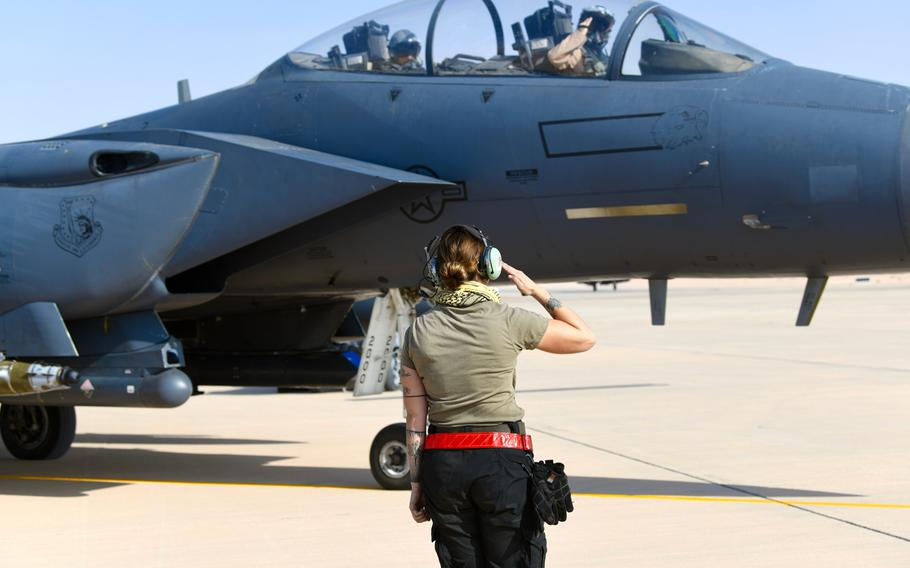 U.S. Air Force Senior Airman Emily Kline, a crew chief with the 378th Expeditionary Maintenance Squadron, salutes an F-15E Strike Eagle pilot prior to a sortie at Prince Sultan Air Base, Kingdom of Saudi Arabia, Jan. 8, 2020.