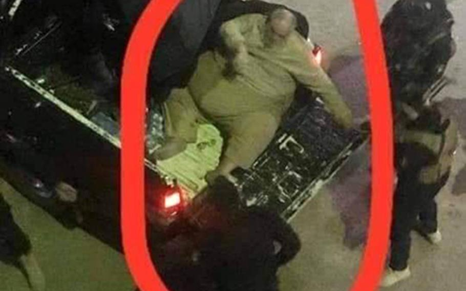 Online pictures of the arrest of Islamic State official Abu Abdul Bari, show that he had to be crammed into the bed of a police pickup truck after his capture in Mosul. Iraqi officials announced Bari's arrest on Thursday, January 16, 2020.
