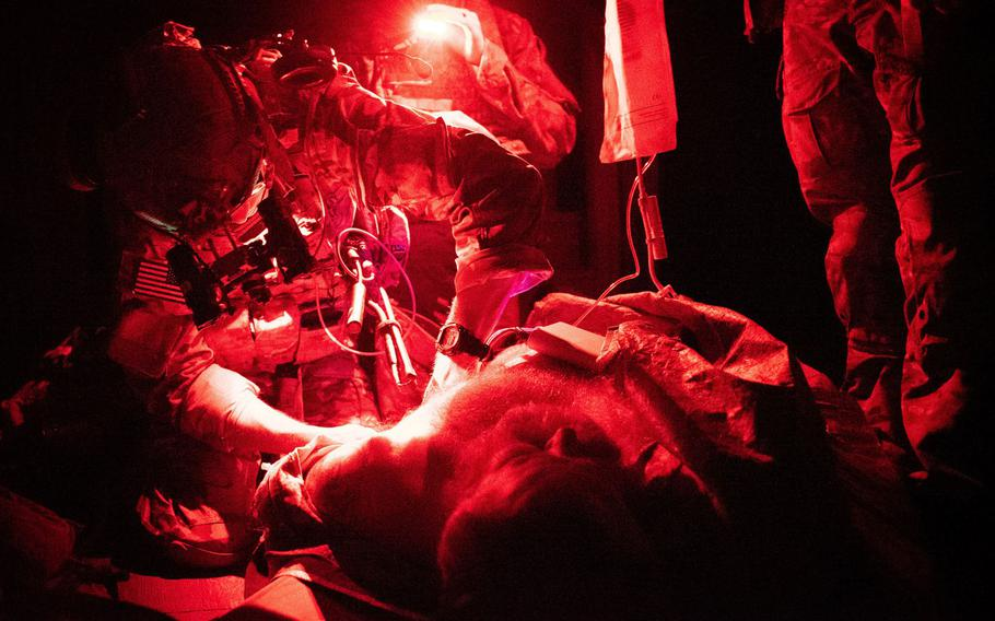 A U.S. Army Ranger combat medic takes part in routine medical training  in August 2019. The Ranger O-Low Titre protocol is practiced multiple times a year to allow volunteer blood donors and medics to maintain a high level of medical proficiency.