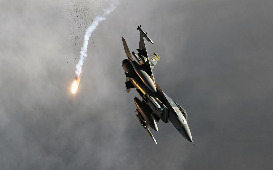 An Air Force F-16 Fighting Falcon from the 79th Fighter Squadron at Shaw Air Force Base, S.C., releases flares over Afghanistan, Nov. 12, 2019. The U.S. dropped more bombs and other munitions in Afghanistan last year than any other year since documentation began in 2006, Air Force data shows.