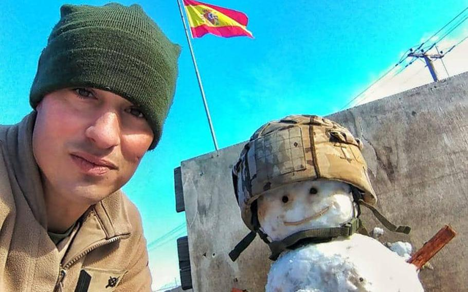 Cpl. David Miranda of the Spanish army is pictured here with a snowman he built at Camp Taji, Iraq, on Tuesday, Feb. 11, 2020, after snow fell on Baghdad.