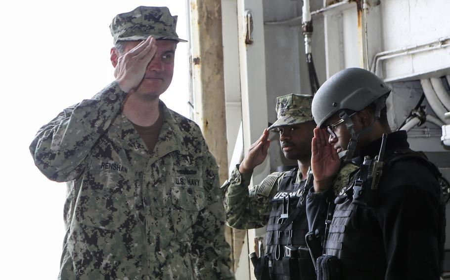 Rear Adm. Curt A. Renshaw, deputy commander of U.S. Naval Forces Central Command, arrives aboard the amphibious assault ship USS Bataan Feb. 17, 2020, at Khalifa Bin Salman Port, Bahrain. The ship stopped briefly in Bahrain after transiting the Strait of Hormuz last week.