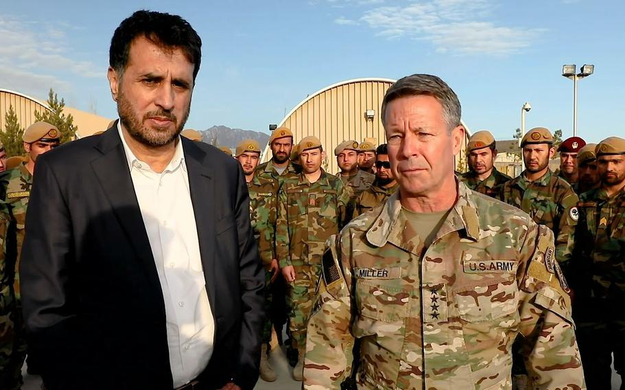 Gen. Scott Miller, the top American commander in Afghanistan, right, and Afghan Defense Minister Asadullah Khalid visit a military base in southern Kandahar province on Tuesday, Feb. 26, 2020, where they said a weeklong period of reduced violence across the country had been successful so far.