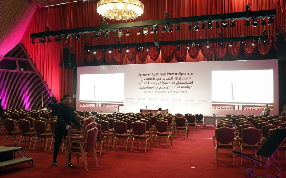 Workers at a luxury hotel in Doha, Qatar, set the stage on Friday, Feb. 28, 2020 for the expected signing of a peace agreement Saturday between the U.S. and the Taliban.
