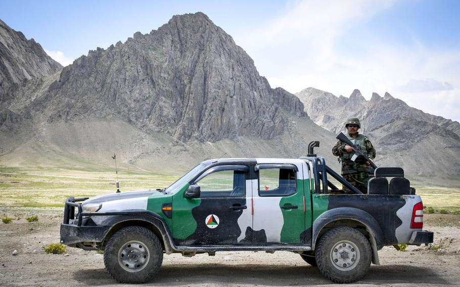 An Afghan soldier guards a highway checkpoint in Logar province on May 2, 2019. The Taliban have resumed offensives against Afghan government forces, days after a partial cease-fire ended and the signing of a peace accord with the U.S.