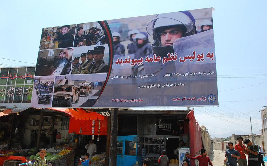 An Afghan national civil order police recruiting billboard in Kabul, Afghanistan in 2010. The Leonie Group, which produced television, radio and billboard ads in Afghanistan, billed the government for ads that were never disseminated, the company's former president alleges in a whistleblower lawsuit.
