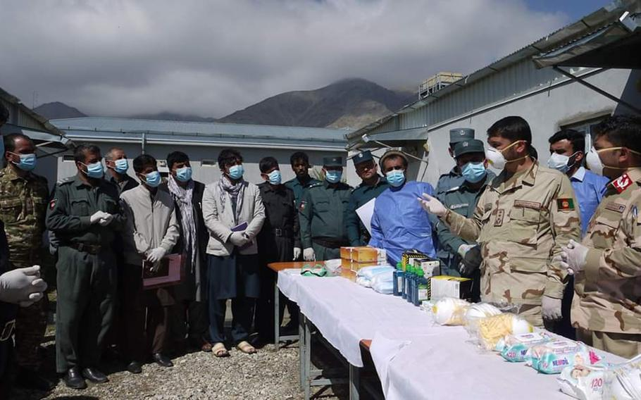 Afghan police receive medical supplies provided by U.S. and NATO forces in Afghanistan to help with efforts to combat the coronavirus pandemic in Panjshir and Parwan provinces, April 9, 2020.