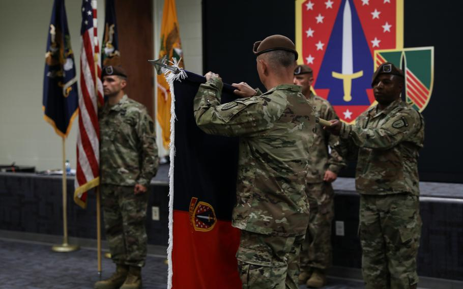 Col. James Dooghan, commander of the 4th Security Force Assistance Brigade, unveils the colors at their activation ceremony, Apr. 28, 2020, at Fort Carson, Colo. The brigade is due to deploy to Afghanistan in the fall.