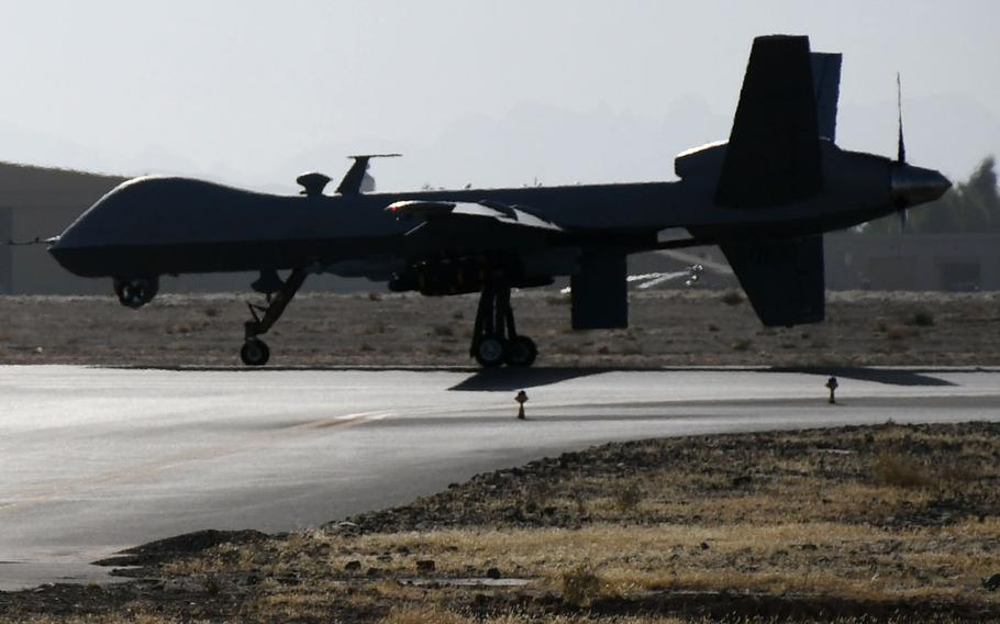A U.S. MQ-9 Reaper drone taxis on the runway at Kandahar Airfield in November 2017.
