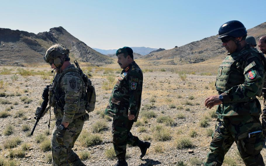 Advisers from the 2nd Security Force Assistance Brigade talk with Afghan forces during their June 2019 deployment to Afghanistan. Most advising has been done remotely since mid-March, an inspector general report said Tuesday.