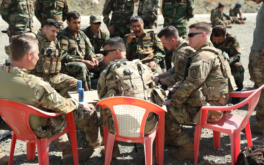 Advisers from the 2nd Security Force Assistance Brigade talk with Afghan forces in March 2019. Most advising has been done remotely since mid-March, an inspector general report said Tuesday.