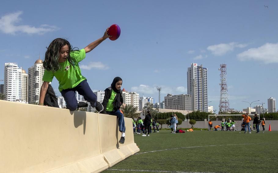 Defense Department elementary school students complete an obstacle course during the annual Sports Day event in Bahrain, Feb. 11, 2020.