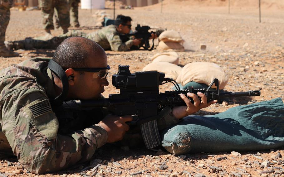 Coalition forces zero Smart Shooter sighting devices during familiarization range training near al-Tanf garrison, Syria, May 30, 2020.