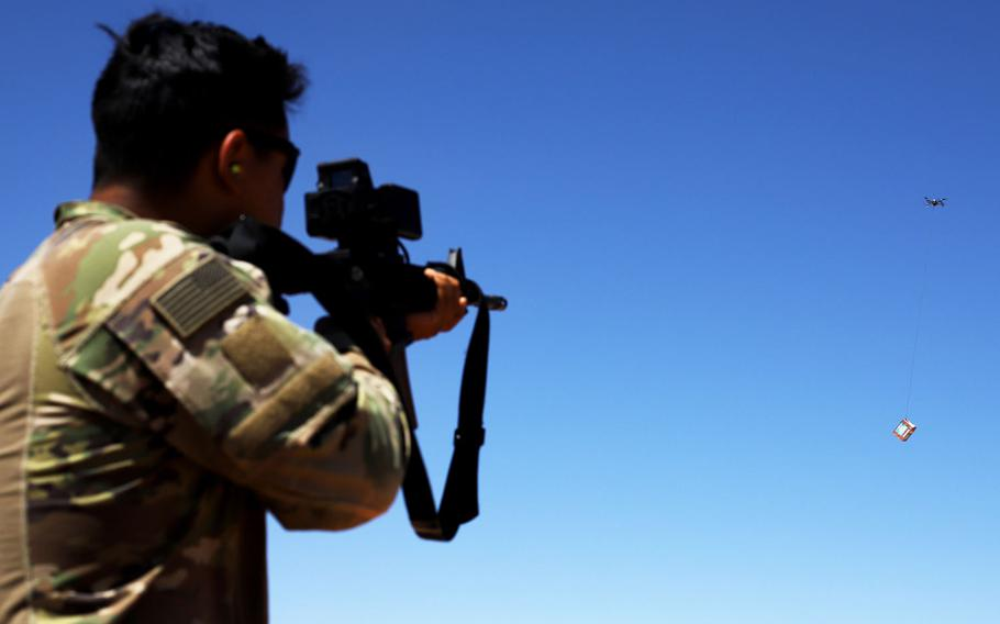 A soldier fires at a box carried by a drone during a Smart Shooter sighting device training event near al-Tanf garrison, Syria, May 30, 2020.