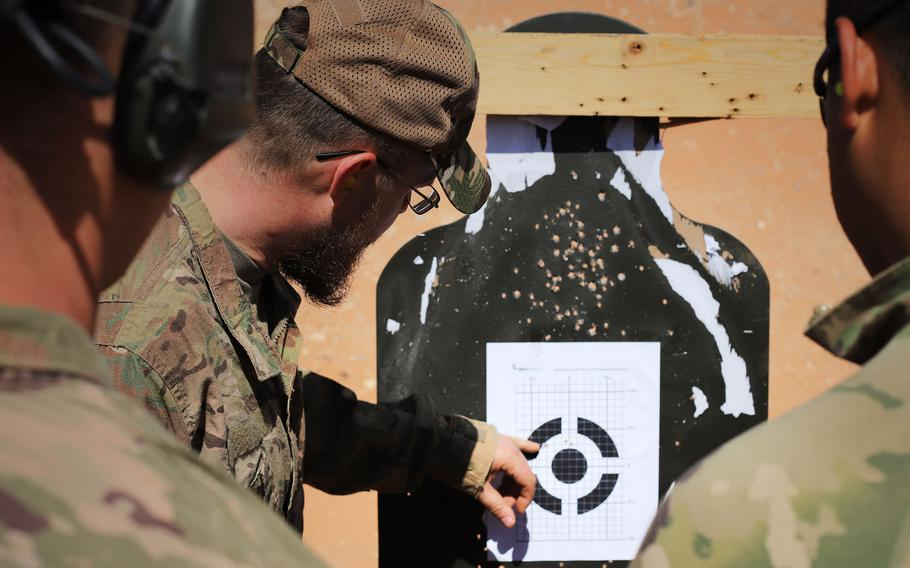 Coalition forces analyze a zero target during a Smart Shooter sighting device familiarization training event near al-Tanf garrison, Syria, May 30, 2020.