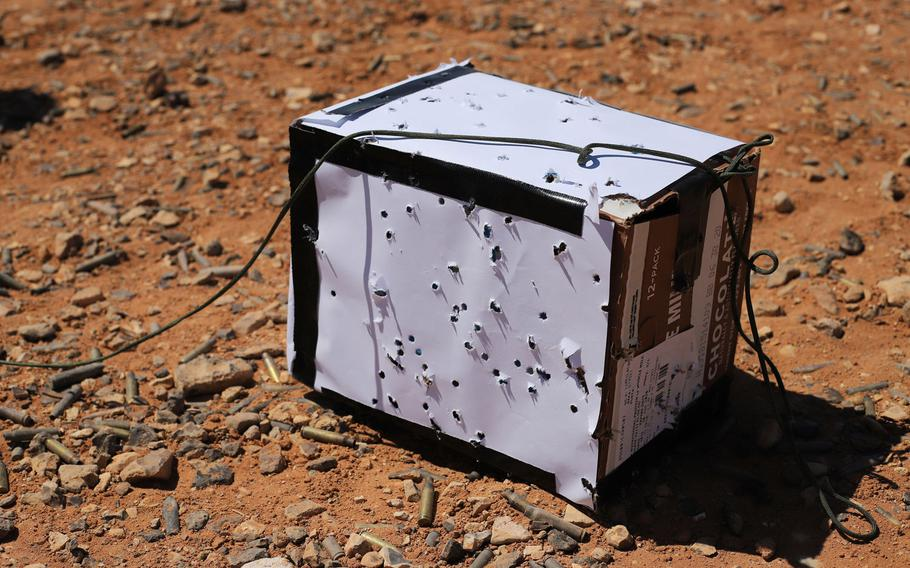A bullet-ridden box used as a target during a Smart Shooter sighting device familiarization range exercise near al-Tanf garrison, Syria, May 30, 2020.