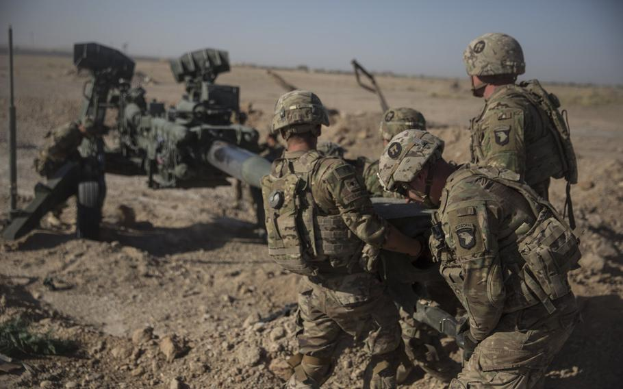U.S. soldiers with Task Force Iron maneuver an M-777 howitzer so it can be towed into position at Bost Airfield, Afghanistan, June 10, 2017. President Donald Trump viewed a troop increase in Afghanistan early in his term as a failure, former National Security Adviser John Bolton said in a book released to the public Tuesday.