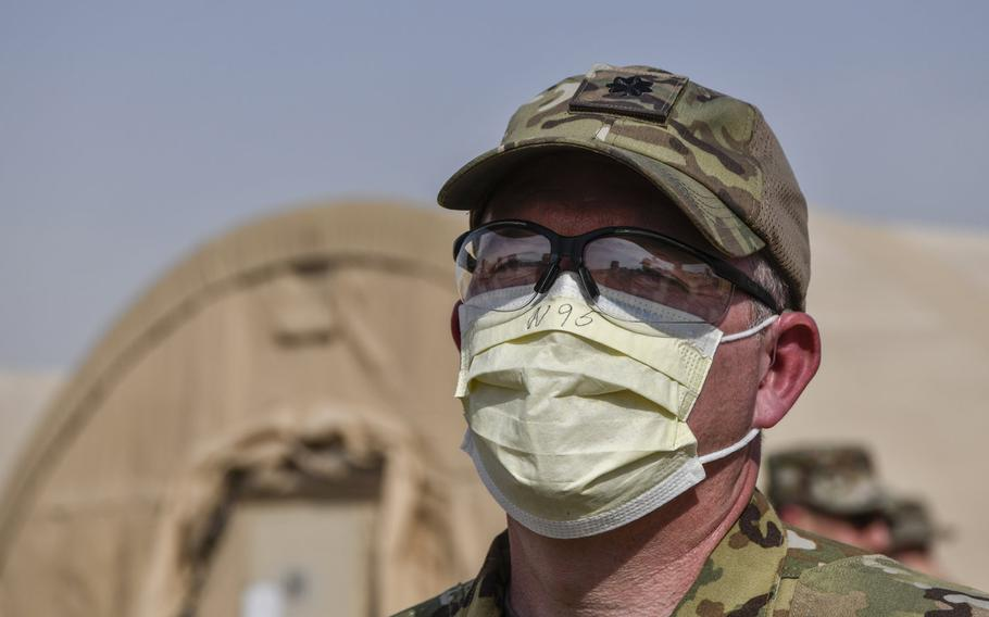 An airman assigned to the 386th Air Expeditionary Wing discusses proposed mitigations during a coronavirus quarantine exercise at Ahmed al-Jaber Air Base, Kuwait, March 13, 2020. A ''cluster'' of COVID-19 cases has developed at the base, officials said.