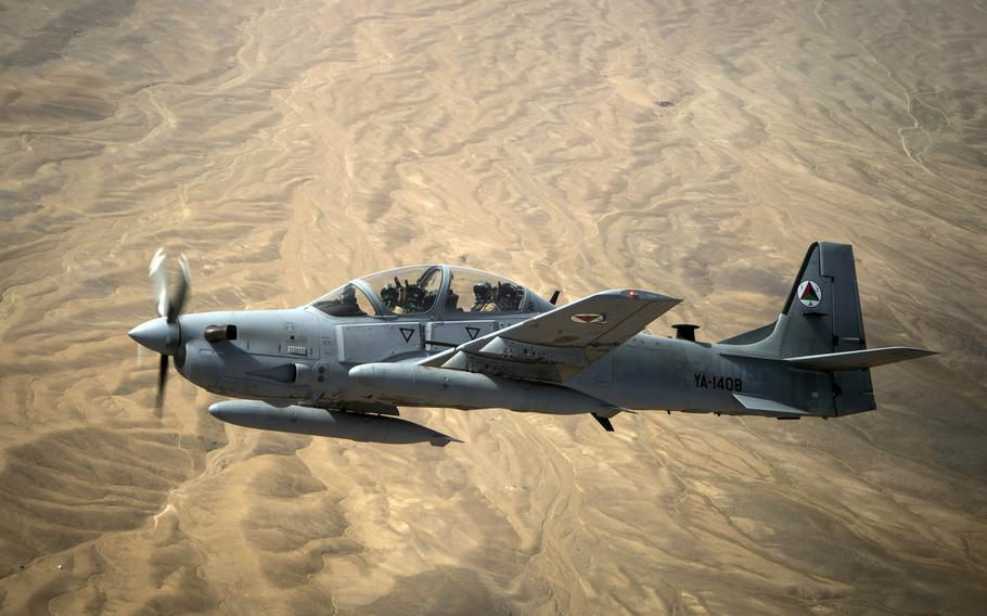 An Afghan air force A-29 Super Tucano flies over Afghanistan in 2015. An American pilot was able to eject when the A-29 plane he was flying crashed in Baghlan province on Thursday, July 9, 2020.