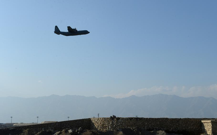 A U.S. Air Force C-130 takes off from Bagram Airfield, Afghanistan, in 2016. Coronavirus travel restrictions have left some 200 foreign contractors who worked for the U.S.-based Fluor Corp. stranded on the base for months.