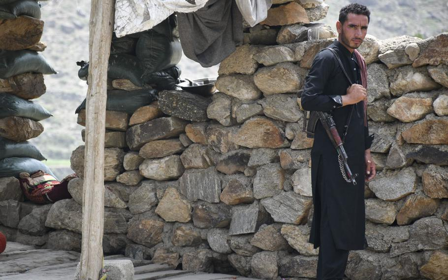 An Afghan militia fighter mans a small outpost in Achin district, Nangarhar province, in eastern Afghanistan, on July 26, 2020. Since the U.S. withdrew from two bases in the province in May and July 2020, the Taliban have stepped up attacks, local officials say.