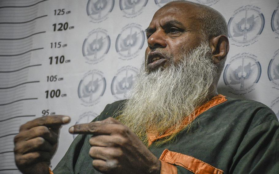 Khalid Haider, 54, a former member of the Islamic State in Afghanistan and al-Qaida, speaks in an Afghan government prison July 18, 2020. Haider said he crossed the border from his home country of Pakistan to join the Islamic State in 2016 and was arrested this spring.