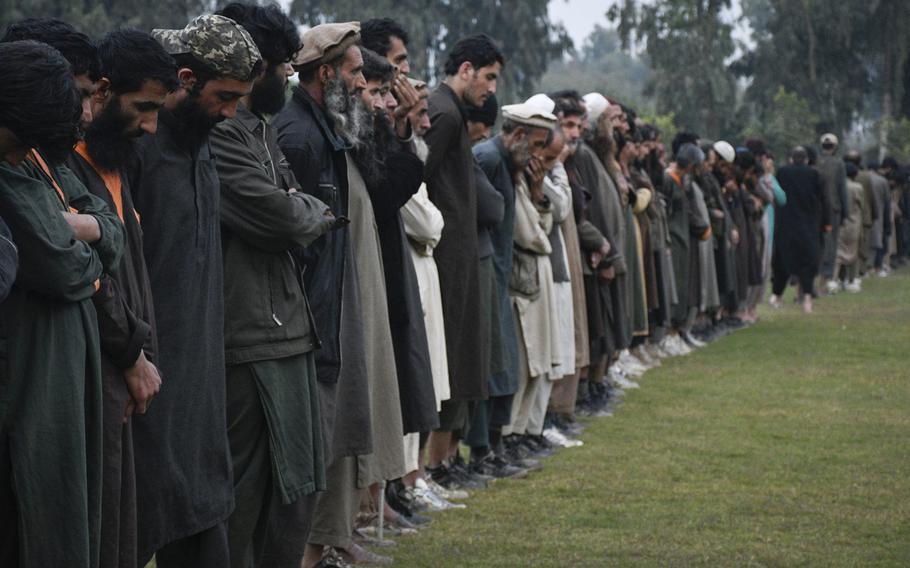Islamic State fighters line up Nov. 19, 2019, in Jalalabad, Afghanistan, after surrendering to the Afghan government. The group has suffered heavy battlefield losses but remains a threat as it aims to recruit Taliban disgruntled by the peace process.