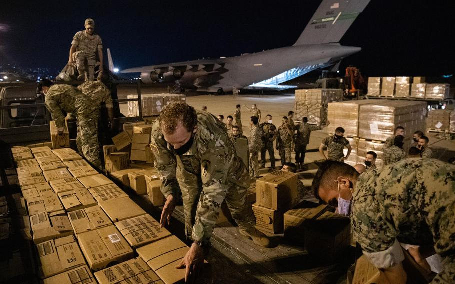 Lebanese and U.S. service members unload humanitarian aid supplies delivered by a U.S. Air Force C-17 Globemaster III at Beirut, Lebanon, Aug. 6, 2020.