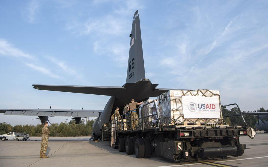 Members of the 721st Aerial Port Squadron load a C-130J Super Hercules at Ramstein Air Base, Germany, Aug. 11, 2020, with relief supplies for Lebanon.