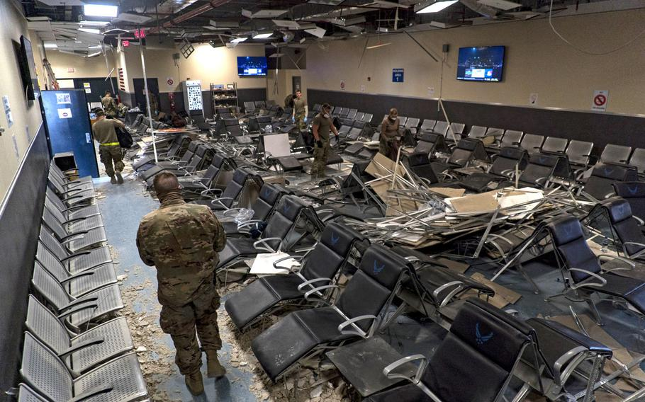 U.S. airmen from the 405th Expeditionary Support Squadron clear debris from inside the passenger terminal at Bagram Airfield on Dec. 12, 2019, a day after a Taliban-led attack on the facility. Iran has been accused  of paying Taliban fighters to kill American and other coalition troops in the country, CNN said in a report.