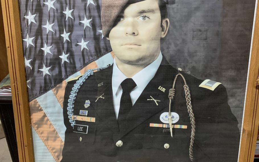 A portrait of U.S. Army 1st Lt. Weston Lee previously hung in the fieldhouse at Camp Taji, Iraq, in honor of his sacrifice when he was killed in action in 2017. As the base was prepared for transfer to Iraqi forces, Lee's portrait was secured before U.S. forces left.