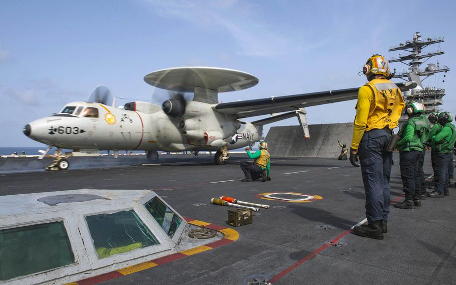 An E-2C Hawkeye launches off the flight deck of the aircraft carrier USS Nimitz in the Arabian Sea, Sept. 3, 2020. The Nimitz and U.S. navy ships were joined by Air Force aircraft in searching for a U.S. sailor missing in the North Arabian Sea since Sept. 6, 2020.