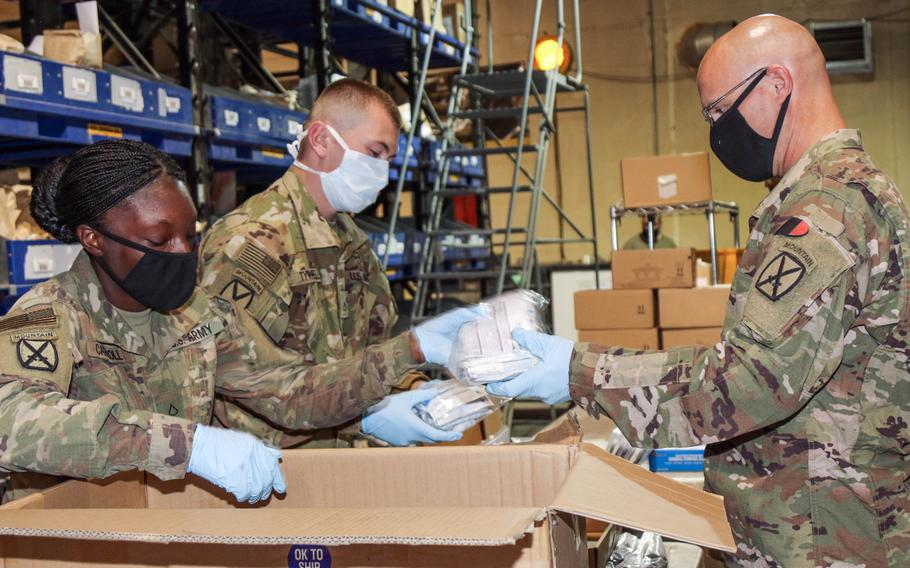 Soldiers from 10th Mountain Division sort testing kits for movement to forward operating base at Bagram Airfield, Afghanistan, April 24, 2020. A report released Monday, Sept. 15, 2020, by the Eurasia Group Foundation found that a majority of Americans prefer diplomacy over military intervention and want the U.S. to withdraw from Afghanistan.