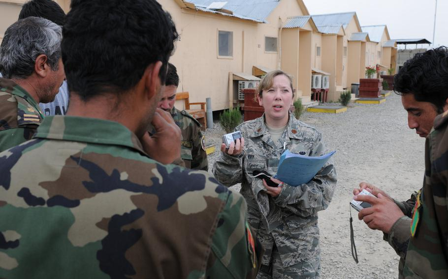 Maj. Christy Barry speaks Dari with Afghan national army officers at the Counter Insurgency Training Academy on Camp Julien, Afghanistan, April 2010. The Afghanistan-Pakistan Hands program, which trained service members to be cultural experts versed in Central Asian languages, ended  Sept. 30, 2020.