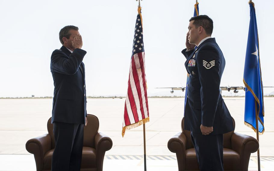 U.S. Air Force Maj. Gen. Barry Cornish, 12th Air Force commander, returns the salute of Staff Sgt. Benjamin Brudnicki, 48th Rescue Squadron pararescueman, during a Bronze Star presentation ceremony at Davis-Monthan Air Force Base, Ariz., Oct. 1, 2020. Brudnicki received the Bronze Star with valor for his actions during a mission last year in Afghanistan.