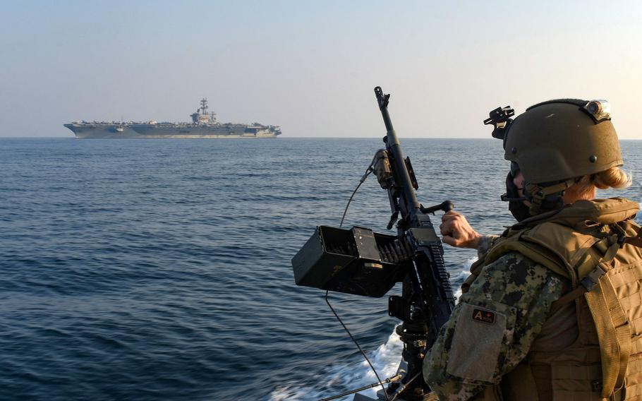 Chief Petty Officer Jennifer Kwiatkowski stands security watch aboard a Mark VI patrol boat during an escort of the aircraft carrier USS Nimitz through the Gulf of Bahrain, inbound to a maintenance and logistics visit in Bahrain, Oct. 7, 2020.
