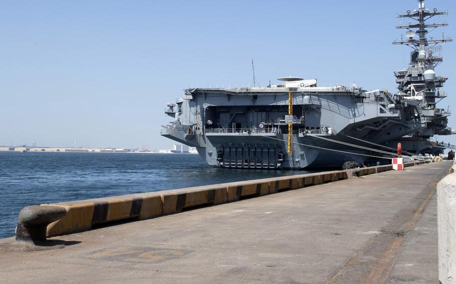 The aircraft carrier USS Nimitz sits pier-side in Bahrain, Oct. 8, 2020. The ship was in Bahrain for a maintenance and logistics visit.