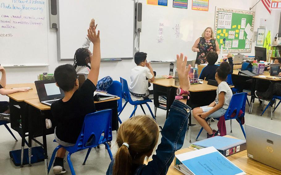 Teacher Heather Heffernan teaches a fifth grade class at Bahrain School in September 2019. High school students at the school are due to return to in-person classes starting Sunday, while elementary and middle school students at the U.S. Navy base on Bahrain returned to school in late September.