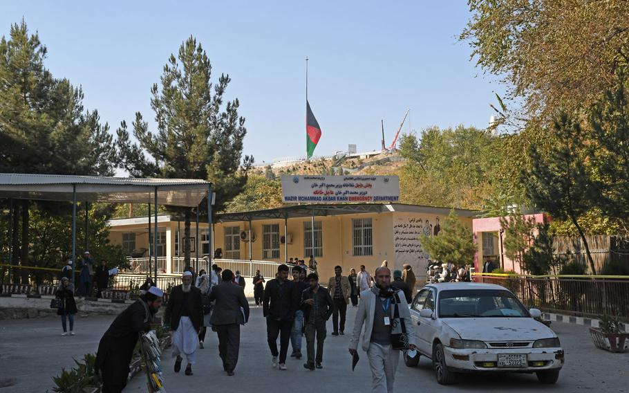 An Afghan flag flies at half-staff over Kabul on Tuesday, Nov. 3, 2020, as the country mourned 22 people, most of them students, who were killed when Islamic State gunmen stormed Kabul University a day earlier.