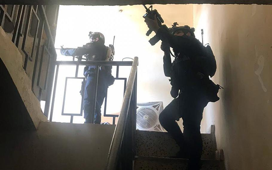 Iraqi counterterrorism troops raid a compound in Fallujah during the last week of October. They captured a suspected member of an Islamic State group child recruitment ring, U.S. and Iraqi officials said.