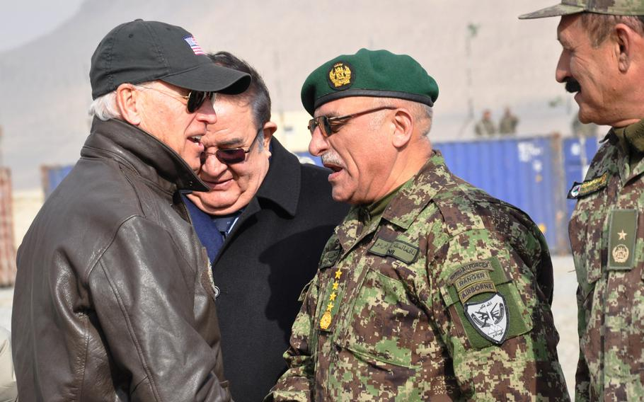 Then-Vice President Joe Biden meets Afghan National Army Chief of Staff Gen. Sher Mohammad Karimi during a tour of the Kabul Military Training Center in 2011. Some Afghan politicians called on President-elect Joe Biden to reevaluate the deal signed in February 2020 between the Trump administration and the Taliban.