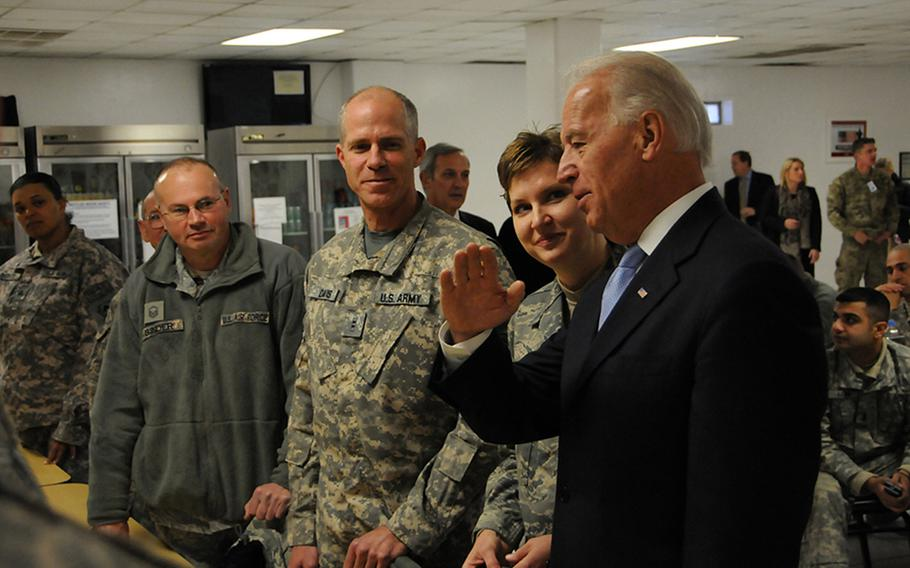 Then-Vice President Joe Biden meets with service members from Delaware during a visit to Bagram Airfield in Afghanistan in 2011. Now the president-elect of the United States, Biden has said he supports keeping a residual counterterrorism force in Afghanistan.
