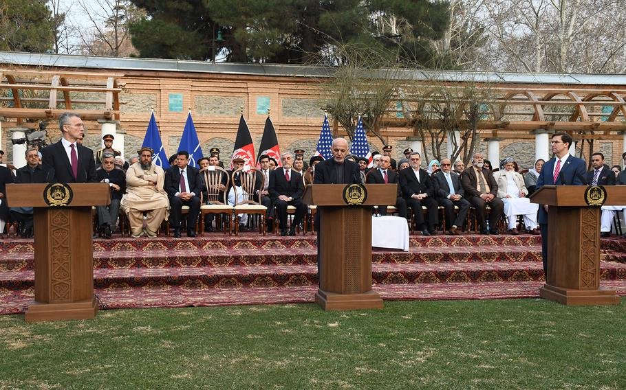 NATO Secretary General Jens Stoltenberg, left, Afghan President Ashraf Ghani and U.S. Defense Secretary Mark Esper announce a joint declaration between the U.S. and Afghanistan for bringing peace Afghanistan on Saturday, Feb. 29, 2020.