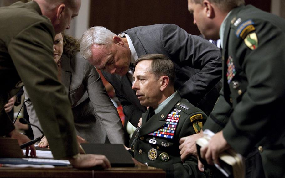 U.S. Central Commander Gen. David Petraeus is surrounded by staff after appearing to be taken ill while testifying before the Senate Armed Services Committee on Tuesday.