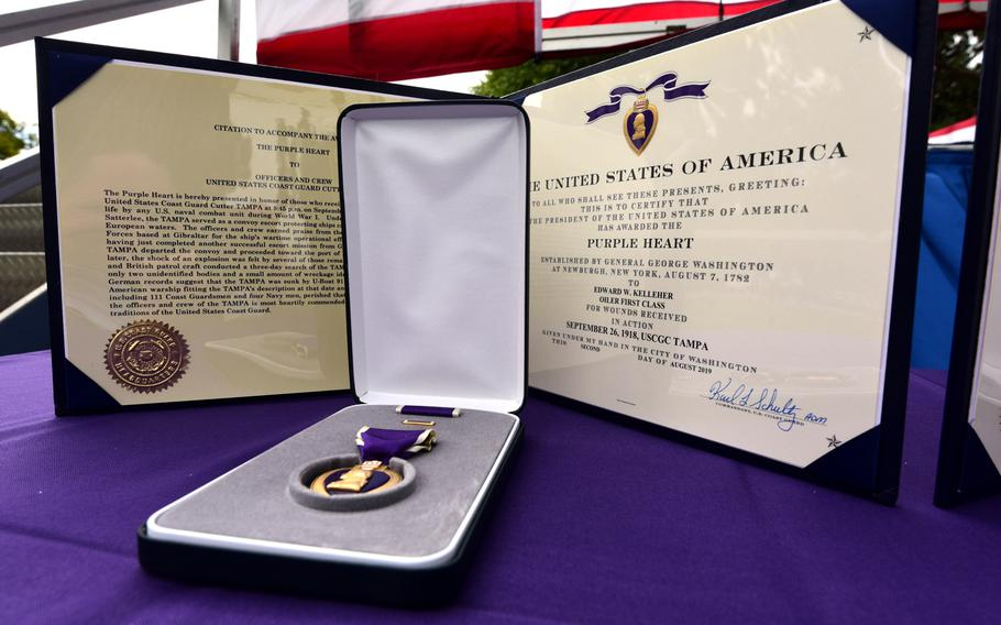 A Purple Heart medal and citation are displayed prior to being posthumously presented during a ceremony on Coast Guard Island in Alameda, Calif., Sept. 3, 2019, to the families of Edward Kelleher and Arthur Deasy, who died when the Coast Guard Cutter Tampa was sunk by a German U-boat during World War I.