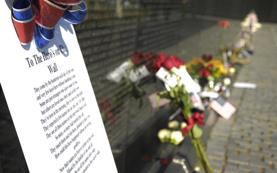 Mementos left at the Vietnam Veterans Memorial on Nov. 11, 2012, pay tribute to those who died in the war.