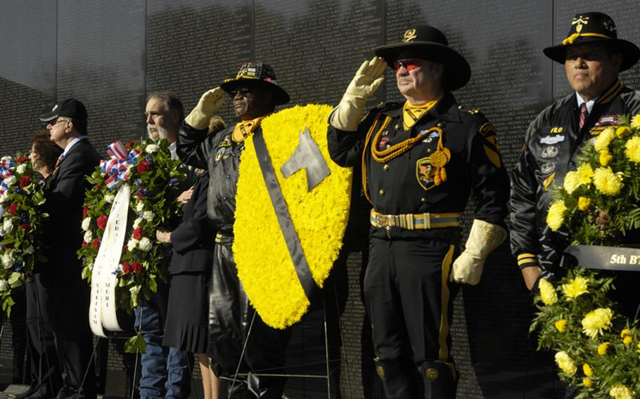 1st Cavalry veterans and other visitors to the Vietnam Veterans Memorial on Nov. 11, 2012 pay tribute to those killed in the war during a wreath-laying ceremony.