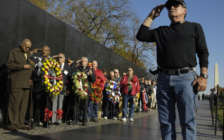 Visitors to the Vietnam Veterans Memorial on Nov. 11, 2012 pay tribute to those who died in the war.
